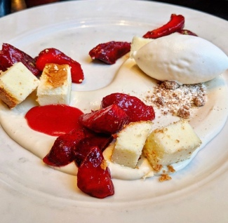 A beautifully composed roasted strawberry, chamomile cream, ice cream and Japanese cheesecake dessert