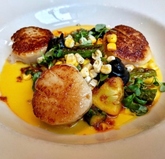 One of our favorite Seattle chefs, Chef Verin from Heartwood Provisions with delicious scallops and corn puree at FareStart.