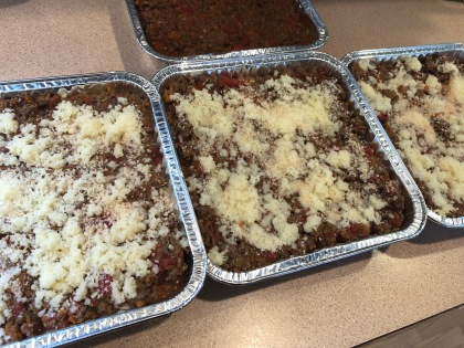 Three sheets of lasagna and one of spaghetti sauce