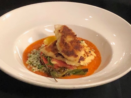 Breaded branzino with couscous and heirloom tomatoes